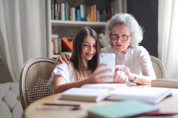 photo-of-woman-showing-her-cellphone-to-her-grandmother-3768140